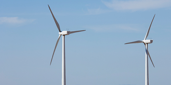 A stock photo of two wind turbines